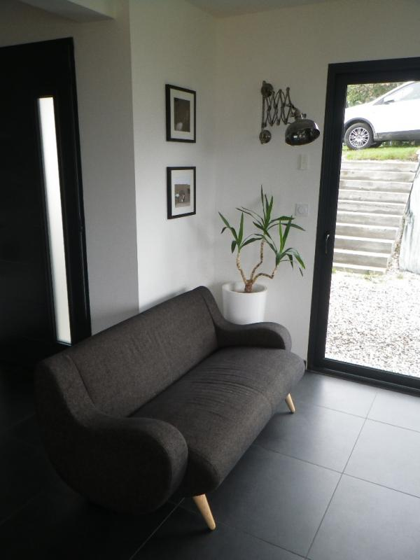 Genève Sofa en Verzilverde schaarlamp