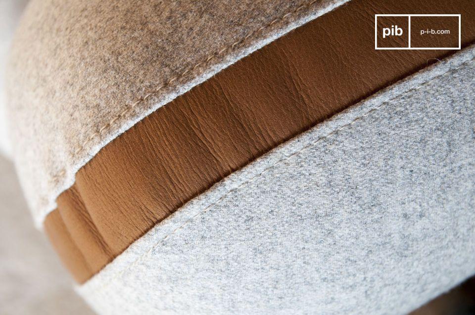 Het solide walnoothouten frame voegt een balans toe aan het geheel door de kleur van het leer te