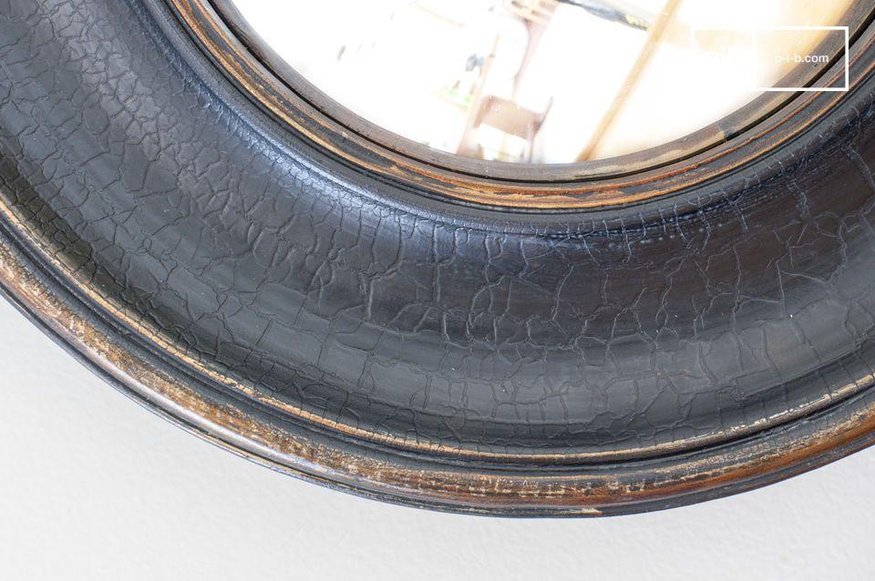 Een mooie cilindrische spiegel met grote gepatineerde randen