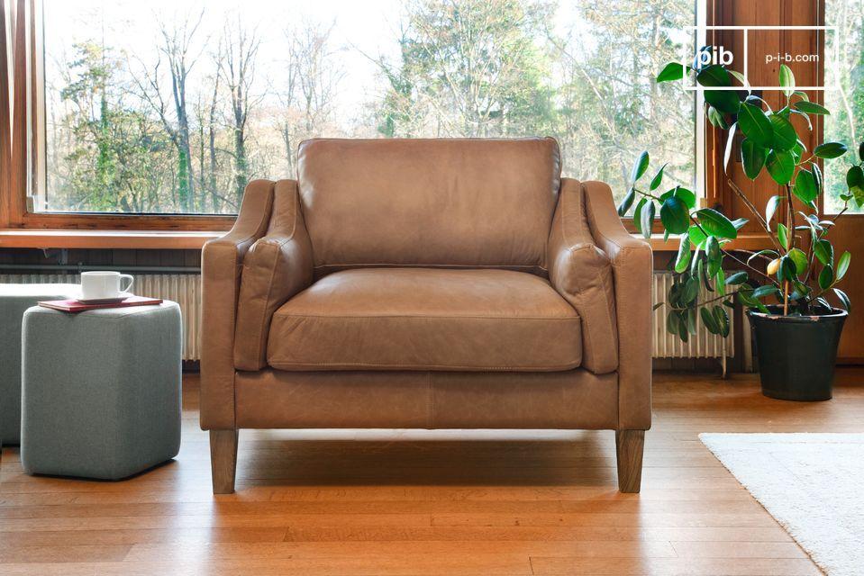 Een elegante zandkleurige fauteuil van 100% volnerfleer