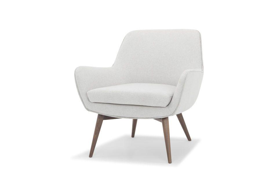 De dubbele leren leidingen geven een fijne vormgeving aan de Järvi fauteuil en benadrukken de