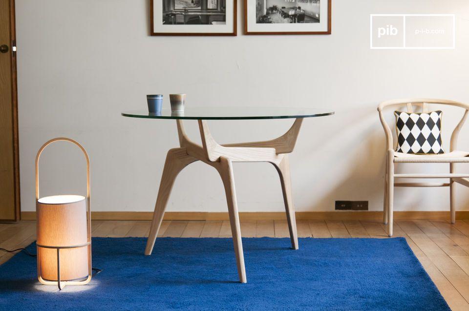 De retro lijnen van een kunstzinnige ronde tafel die glas en hout combineert