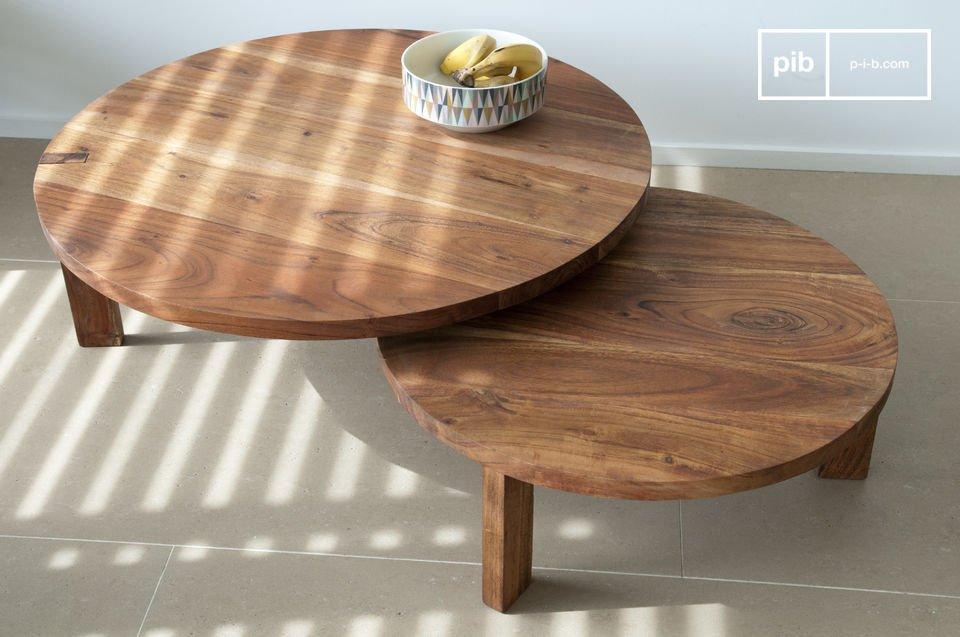 Een verstelbare tafel die een mooie Scandinavische soberheid toont, de salontafel bestaat uit twee schijven van 80 cm doorsnee roterend ten opzichte van elkaar, waardoor het  zich aanpast aan de beschikbare ruimte