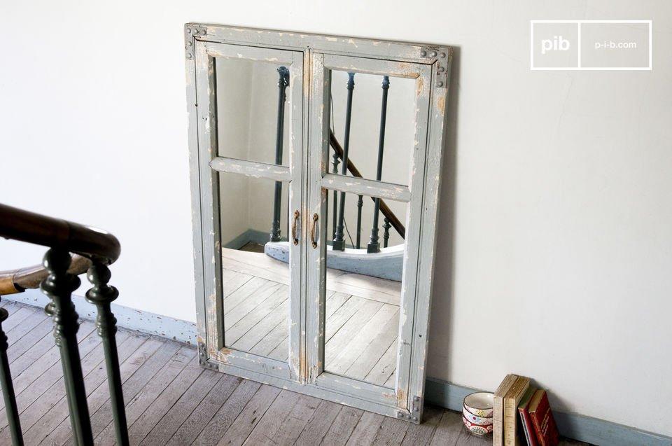 De mat grijze afwerking en de geklonken beugels tot aan de handgrepen maken deze Sweet Window uniek