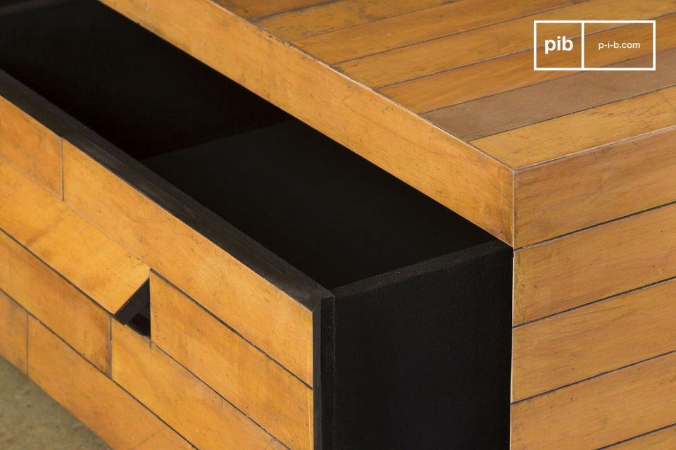 Aan de zijkant van de salontafel is een verborgen handvat, die toegang geeft tot een ruime lade bekleed met zwart linnen